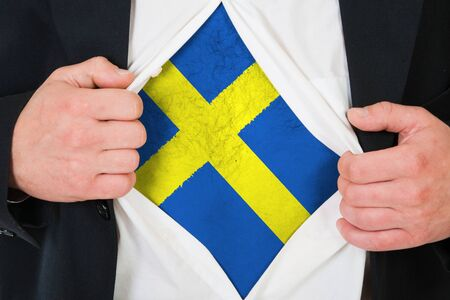 The Swedish flag painted on the chest of a man photo