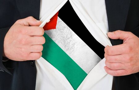 palestinian: The Palestinian flag painted on the chest of a man