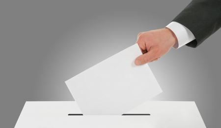 Man's hand down the ballot photo