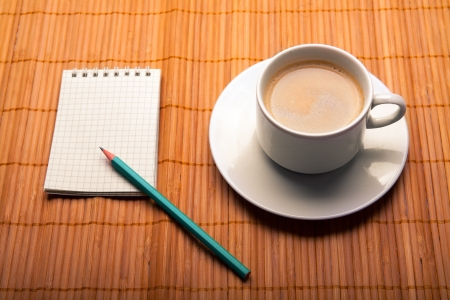 blank notebook coffee cup on wooden background photo