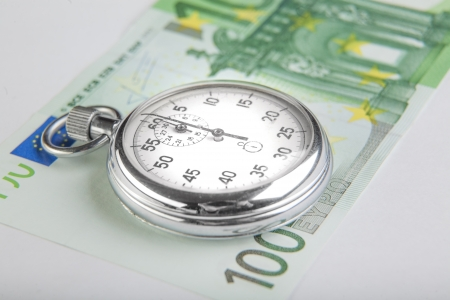 Stopwatch and a hundred euro banknote photo