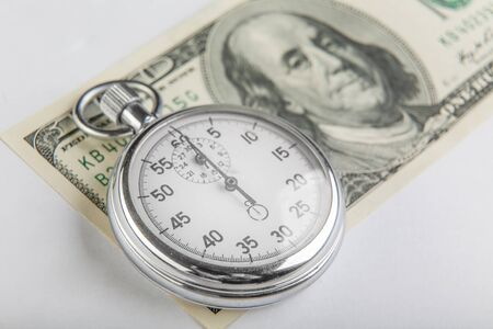 Stopwatch and a hundred American dollars Stock Photo - 18243295