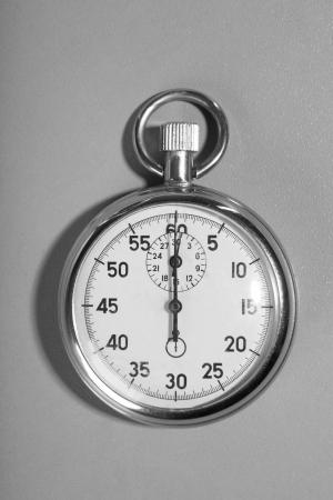 Stopwatch on a gray background photo