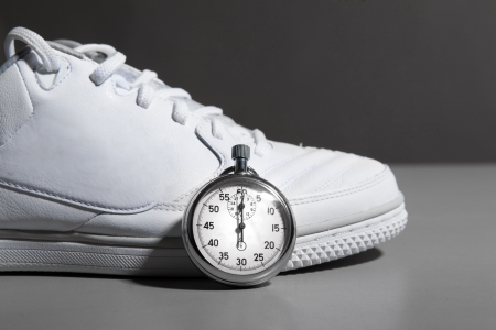 Running Shoes and stopwatch Фото со стока