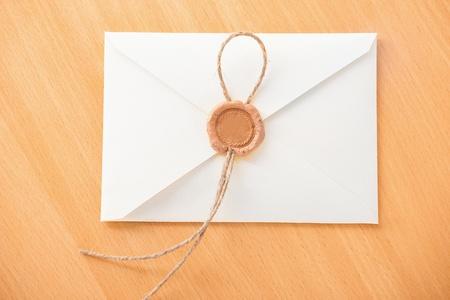 White envelope on wooden table  photo