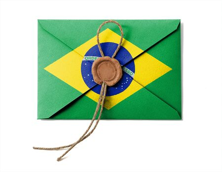 The Brazilian flag on the mail envelope. Isolated on white. photo