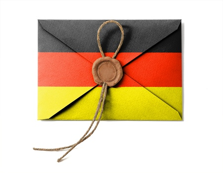 The German flag on the mail envelope. Isolated on white. photo
