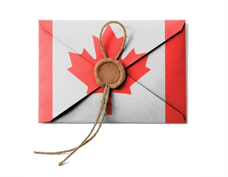 The Canadian flag on the mail envelope. Isolated on white. photo
