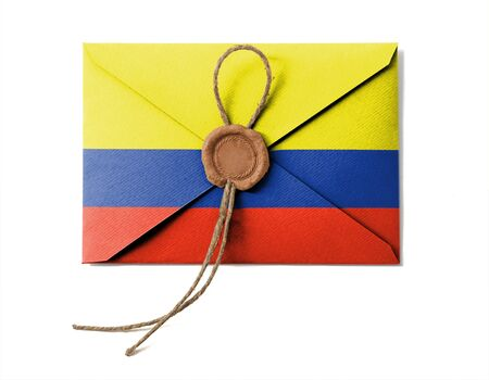 The Colombian flag on the mail envelope. Isolated on white. photo