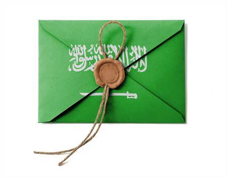 The Saudi Arabia flag on the mail envelope. Isolated on white. photo