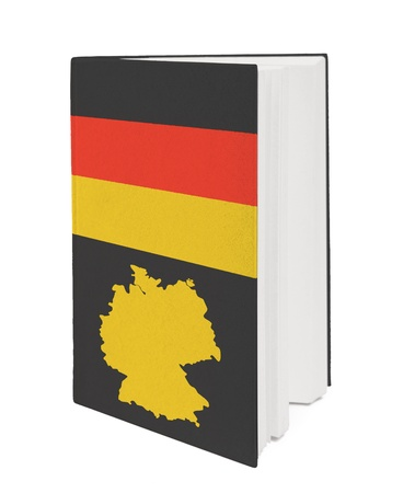 Book with the national flag and contour of Germany on cover. photo