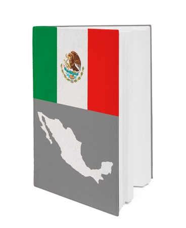 Book with the national flag and contour of Mexico on cover. photo