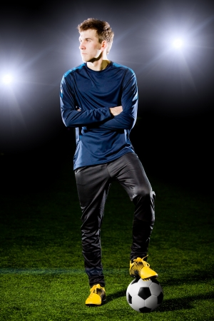 football player on grass field  photo