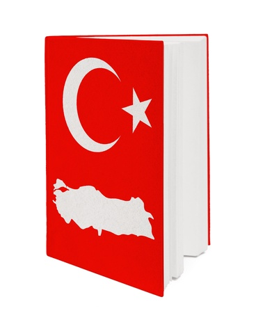 Book with the national flag and contour of Turkey on cover. photo