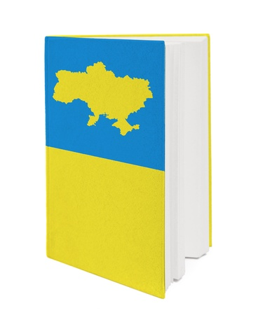 Book with the national flag and contour of Ukrine on cover. photo