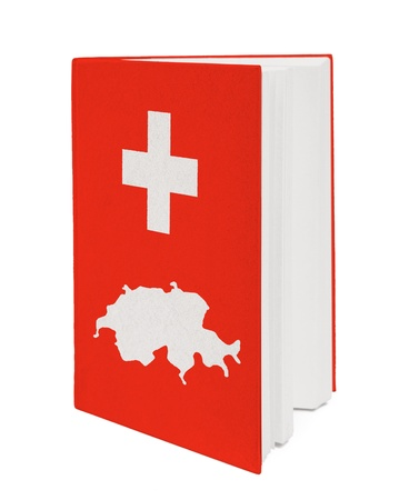 Book with the national flag and contour of Switzerland on cover. photo