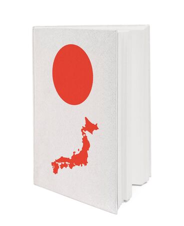 Book with the national flag and contour of Japan on cover. photo