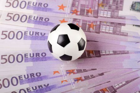 Soccer ball on background of euro banknotes  photo