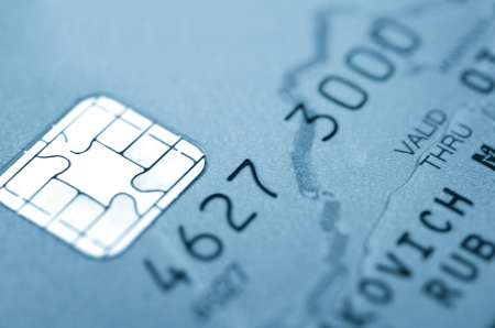 Details of a credit card with chip and numbers  Macro  photo