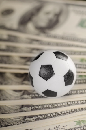 Soccer ball on background of dollars banknotes  photo
