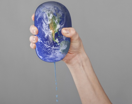 The planet Earth in a woman hands  photo