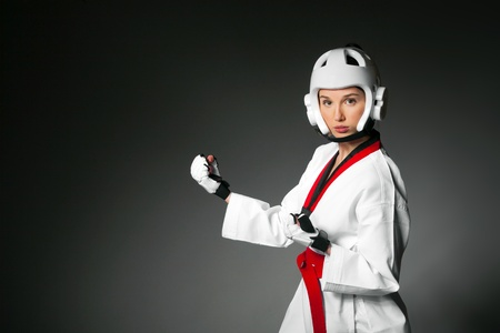 Woman in sports clothing on the gray background  photo