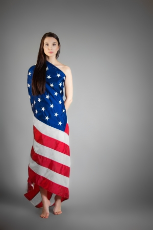woman in the American flag on the gray background photo