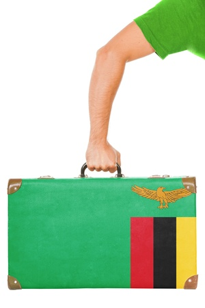 zambian flag: The Zambian flag on a suitcase  Isolated on white