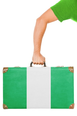nigerian: The Nigerian flag on a suitcase  Isolated on white
