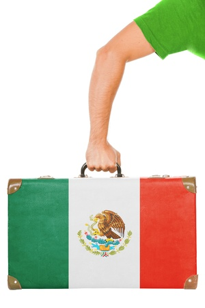 The Mexican flag on a suitcase  Isolated on white  photo