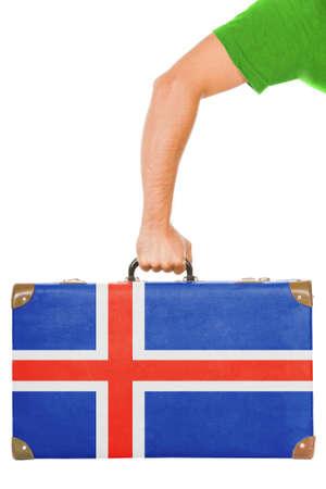 icelandic flag: La bandera de Islandia en una maleta aislado en blanco