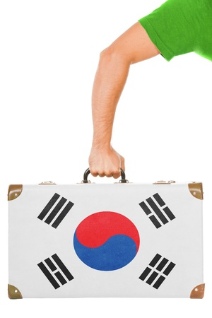 The South Korea flag on a suitcase  Isolated on white  photo