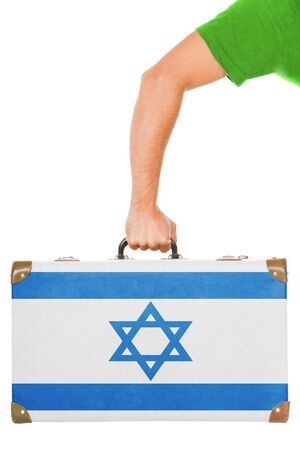 The Israeli flag on a suitcase  Isolated on white  photo