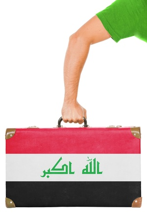 iraqi: The Iraqi flag on a suitcase  Isolated on white