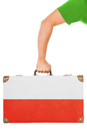 emigration: The Polish flag on a suitcase  Isolated on white
