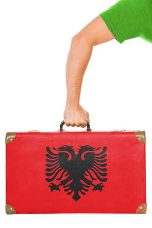 albanian: The Albanian flag on a suitcase  Isolated on white  Stock Photo