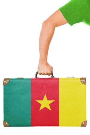 cameroonian: The Cameroonian flag on a suitcase  Isolated on white  Stock Photo