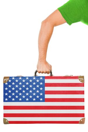 The USA flag on a suitcase  Isolated on white  photo