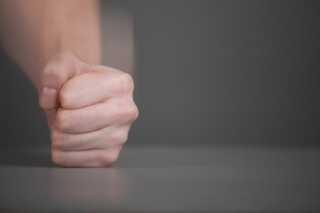 reproach: Man fist hit with a sweep of the table