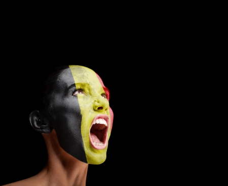 outcry: The Belgian flag on the face of a screaming woman  concept Stock Photo