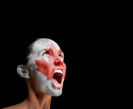 The Canadian flag on the face of a screaming woman  concept photo