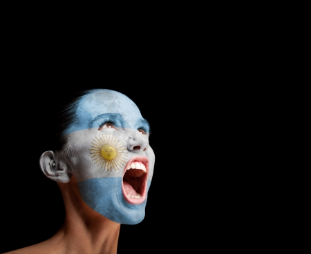 The Argentine flag on the face of a screaming woman  concept photo