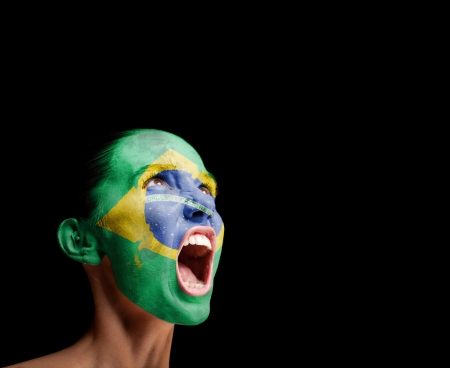 The Brazilian flag on the face of a screaming woman  concept photo