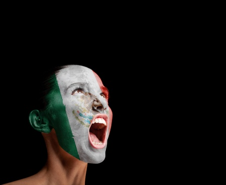 protest signs: The Mexican flag on the face of a screaming woman  concept Stock Photo