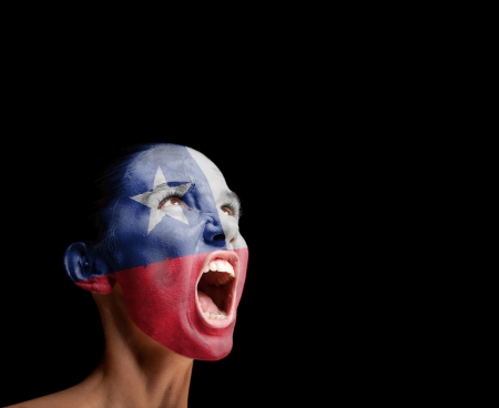 The Chile flag on the face of a screaming woman  concept Фото со стока