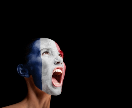 woman screaming: The French flag on the face of a screaming woman  concept