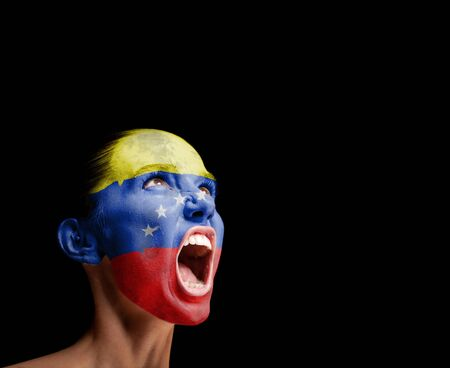 outcry: The Venezuelan flag on the face of a screaming woman  concept Stock Photo