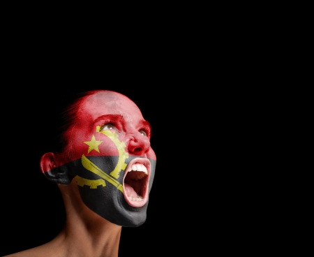 outcry: The Angolan flag on the face of a screaming woman  concept