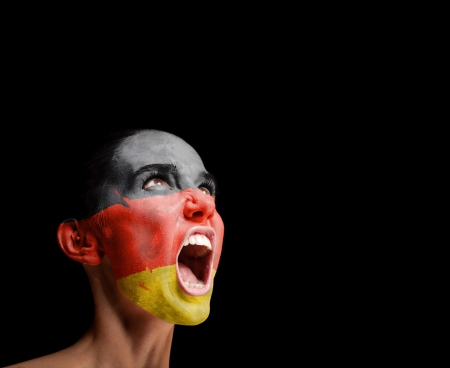 woman screaming: The German flag on the face of a screaming woman  concept