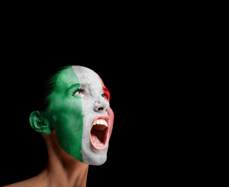 The Italian flag on the face of a screaming woman  concept photo
